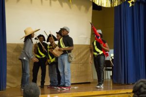 5th graders at Fairfield Court Elementary act out a scene of their skit at the Black History Month Program.